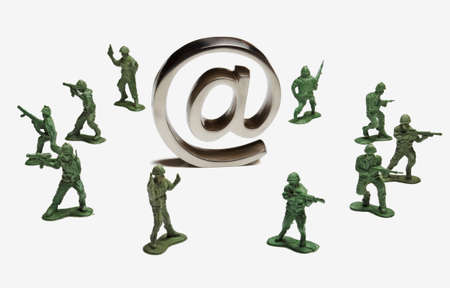 Toy soldiers surrounding an at symbol