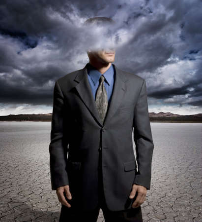 spacey: Digital composite of a man with his head in the clouds Stock Photo