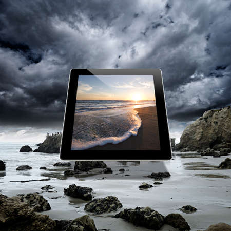 Image of a serene beach sunset on a digital tablet