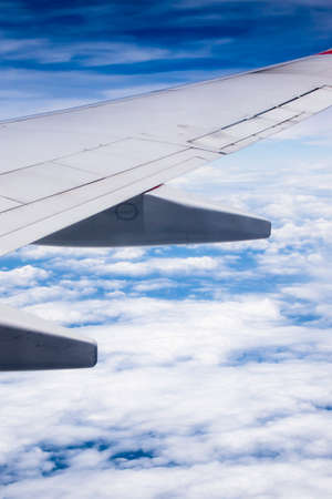 airplane wing: Airplane wing with clouds