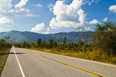 Country road to the mountain in Thailand photo