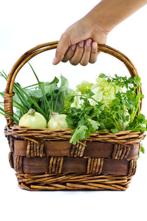 hand baskets: Hand that choose vegetable in the basket Stock Photo