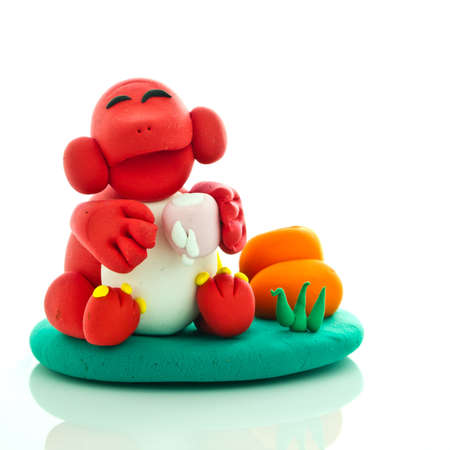 Mono sonriente hechos de plastilina de juego de niños Foto de archivo - 9691257