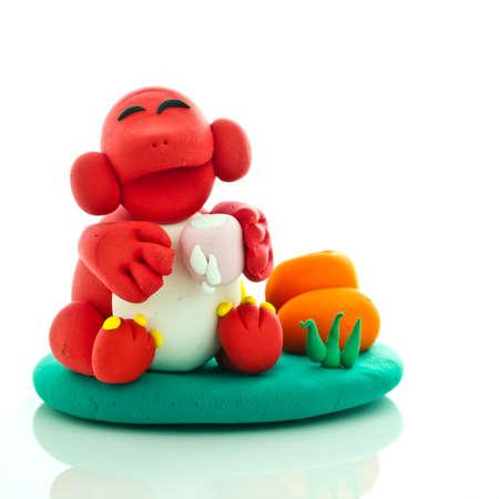 Mono sonriente hechos de plastilina de juego de ni�os Foto de archivo - 9691257