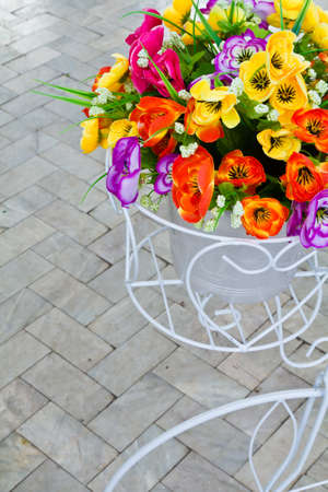 pleasure craft: Artificial flower bouquet in bycicle baskets model
