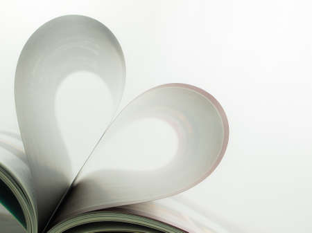 Magazines page folded as a heart photo