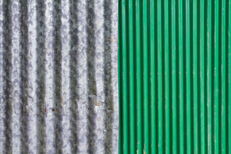 corrugated iron: Gray and green corrugated iron Stock Photo