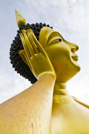 reclining: Side of reclining Buddha statue against the bright sky