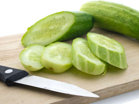 trencher: Cucumbers and knife on chopping board