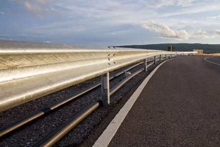 Barrier along the road on the dam photo
