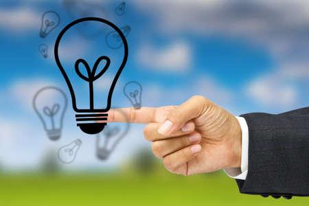 Hand point the light bulbs Stock Photo - 11017799