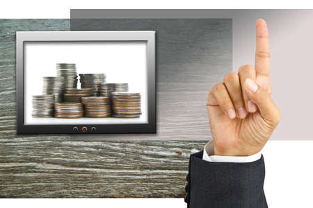 Hand show one finger and coins on screen Stock Photo - 11017809