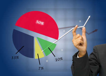 Hand adjust the graph with colorful chart Stock Photo - 11108637