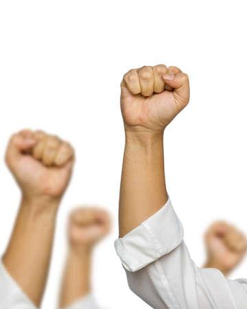 victoire: Poings de l'�quipe entreprise isol�e sur fond blanc