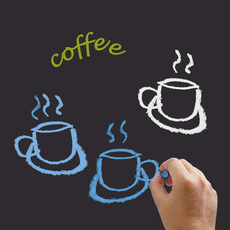 Hand drawing the icon of coffee with chalk photo