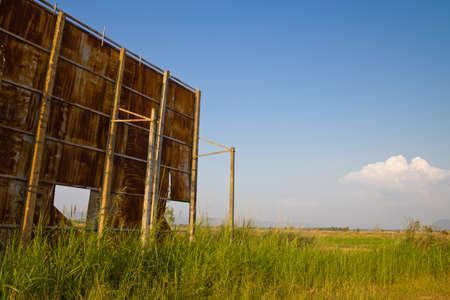 Huge rusty billboard in paddy and grass field Stock Photo - 11487511
