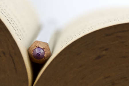 Closeup of pencil on old book photo