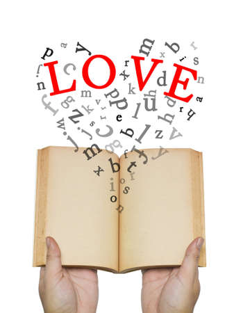 Love and letters spread out of the opened book photo