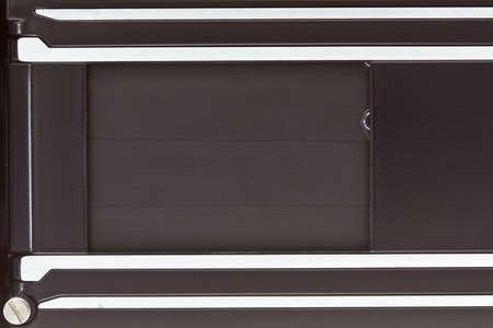 Metallic shutter curtain of retro camera photo