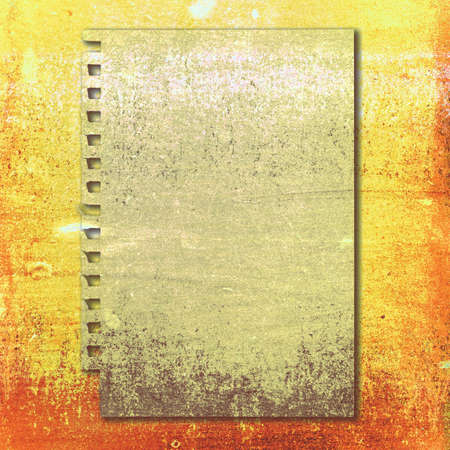 Grunge paper on yellow and orange background photo