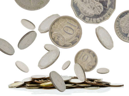 Coins falling with pile of money photo