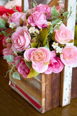 Artificial rose bouquet in wood vase Stock Photo - 12910632
