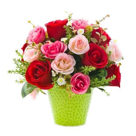 vase: Artificial rose flowers in green vase on white background