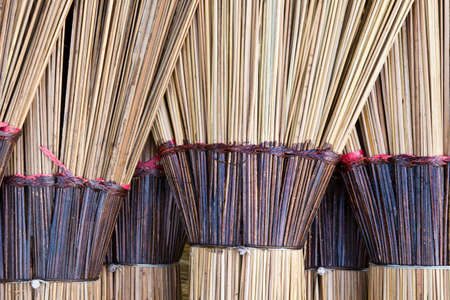 Closeup of dried coconut leaves brooms photo