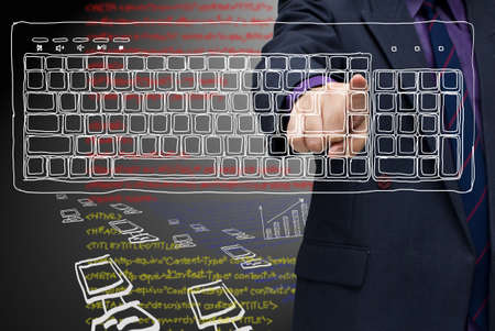 Businessman press on sketching computer keyboard (computer generation) photo