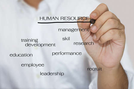 expertise concept: Man in white shirt write a Human resource concept