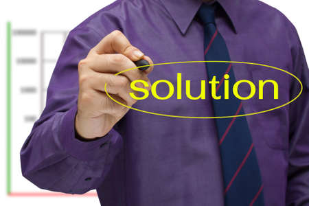 Businessman write a circle on solution word Stock Photo - 15034453