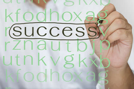 Hand drawing circle on success in puzzle Stock Photo - 15389746