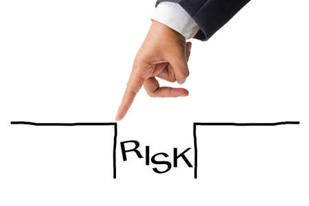 Business hand as finger jumping over the risk hole Stock Photo - 15636133