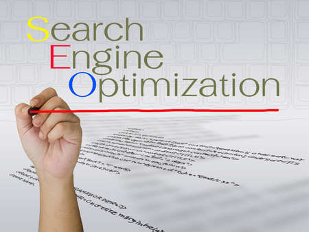 Hand writing search engine optimization concept photo