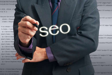 Businessman with pen in SEO concept Stock Photo - 15914757