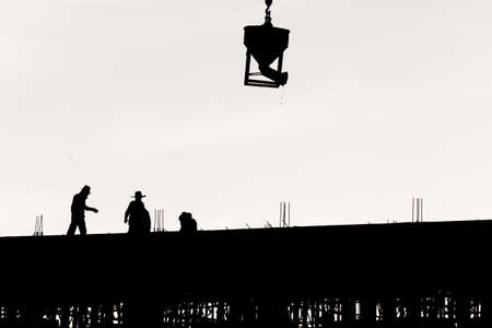 atmosphere construction: Silhouette worker at construction site