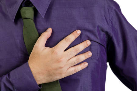 Closeup male hand that suffer from heart attack photo
