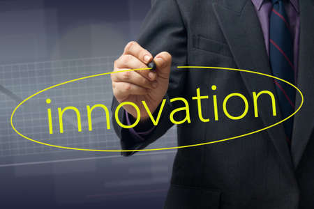 Businessman draw a circle on Innovation word Stock Photo - 16455828