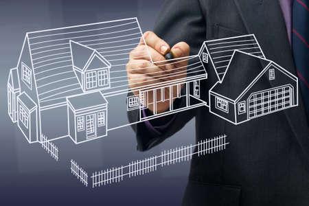 Businessman sketching house