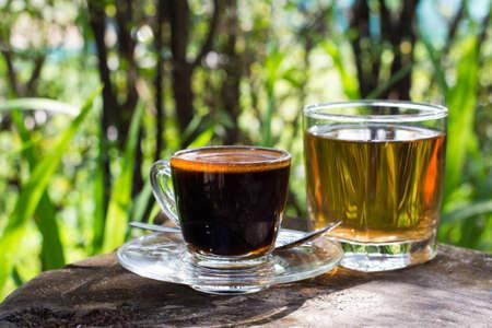 Black coffee with tea water in the garden Banco de Imagens