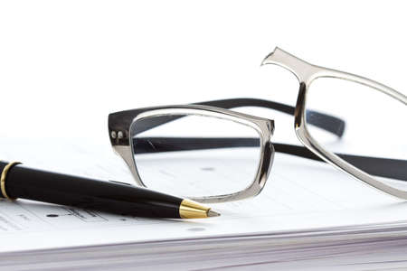 Broken eyeglasses on document papers Stock Photo - 16664293