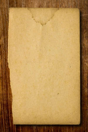 water stained: Aged paper with water stained on wood background