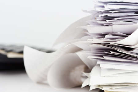 slip: Stack of reciept bills on business desk
