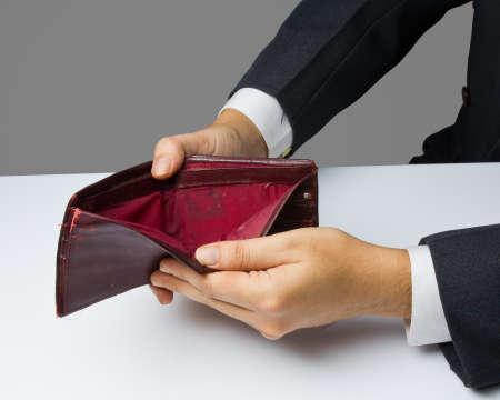 indigent: Businessman show an empty old wallet