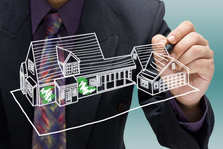 Businessman sketching house model photo