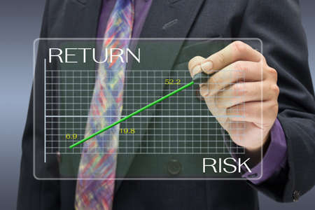 Businessman pointing on investment graph Stock Photo - 17230024