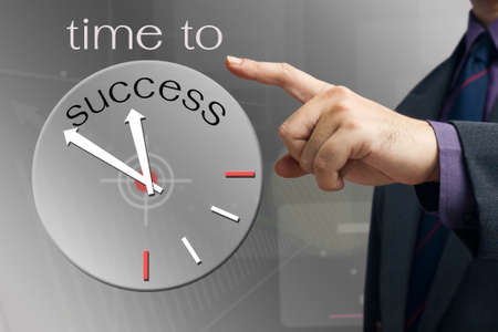 Businessman pointing a success clock photo