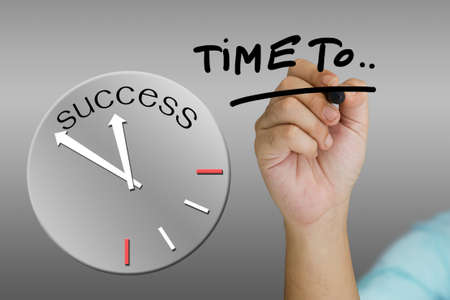 Hand underline a word with success clock Stock Photo - 17229997