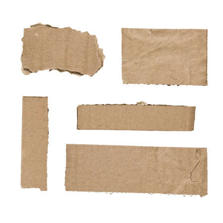 Pieces of cut cardboard isolated on white background photo