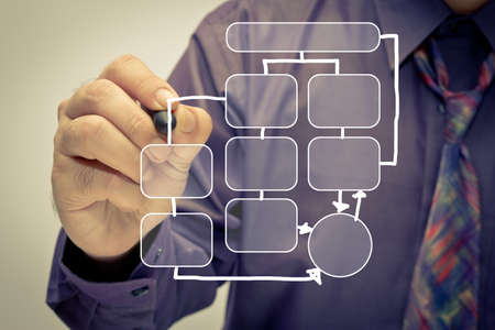 Businessman draw a flow chart Stock Photo - 17617121